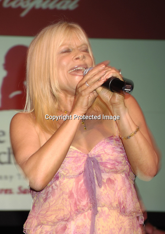 Ilene Kristen of One LifeTo Live singing ..at the 11th Annual Daytime Television Salutes St. Jude Children's Research Hospital benefit hosted by Martha Byrne on October 14, 2005 at The New York Marriott Marquis Hotel. ..Photo by Robin Platzer, Twin Images
