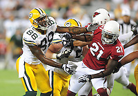 Aug. 28, 2009; Glendale, AZ, USA; Green Bay Packers tight end (88) Jermichael Finley defends a kick under pressure from Arizona Cardinals safety (21) Antrel Rolle during a preseason game at University of Phoenix Stadium. Mandatory Credit: Mark J. Rebilas-