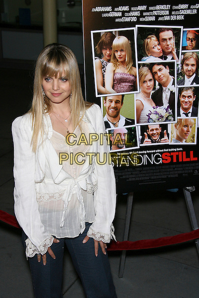 "MENA SUVARI.""Standing Still"" Los Angeles Premiere - Arrivals held at the Arclight Cinemas, Hollywood, California, USA..April 10th, 2006.Photo: Zach Lipp/AdMedia/Capital Pictures.Ref: ZL/ADM.half length white top.www.capitalpictures.com.sales@capitalpictures.com.© Capital Pictures."