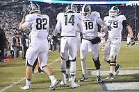 29 November 2014:  Michigan State WR Tony Lippett (14) celebrates with QB Connor Cook (18) after his third quarter touchdown catch. The Michigan State Spartans defeated the Penn State Nittany Lions 34-10 at Beaver Stadium in State College, PA.