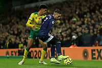 8th November 2019; Carrow Road, Norwich, Norfolk, England, English Premier League Football, Norwich versus Watford; Gerard Deulofeu of Watford is under pressure from Jamal Lewis of Norwich City - Strictly Editorial Use Only. No use with unauthorized audio, video, data, fixture lists, club/league logos or 'live' services. Online in-match use limited to 120 images, no video emulation. No use in betting, games or single club/league/player publications