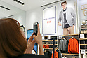 A woman takes a picture of Uniqlo x Ines de La Fressange AW17 collection at Uniqlo store in Ginza on September 5, 2017, Tokyo, Japan. Japanese casual clothing chain Uniqlo and French fashion icon Ines de la Fressange are collaborating with a Fall/Winter 2017 collection which is being sold in selected Uniqlo stores from September 1st. (Photo by Rodrigo Reyes Marin/AFLO)