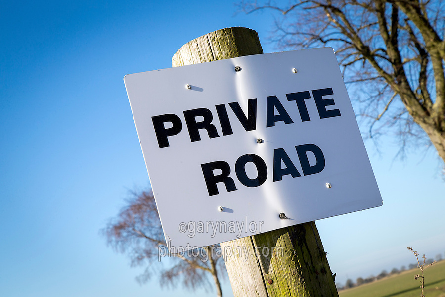 Private road sign at farm road entrance