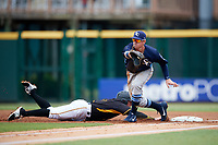 Charlotte Stone Crabs first baseman Brendan McKay (31) stretches for a pickoff attempt throw as Mitchell Tolman (6) dives back to the bag safely during a game against the Bradenton Marauders on June 3, 2018 at LECOM Park in Bradenton, Florida.  Charlotte defeated Bradenton 10-1.  (Mike Janes/Four Seam Images)