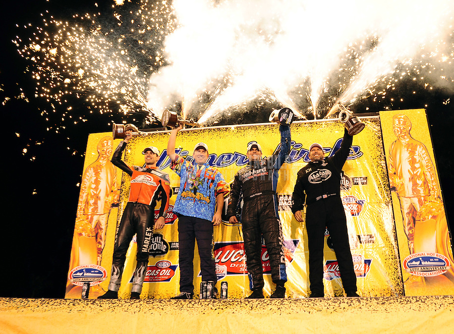 Nov. 13, 2011; Pomona, CA, USA; NHRA top fuel dragster driver Del Worsham (right to left) celebrates with funny car driver Matt Hagan , pro stock driver Greg Stanfield and pro stock motorcycle rider Andrew Hines after winning the Auto Club Finals at Auto Club Raceway at Pomona. Mandatory Credit: Mark J. Rebilas-.