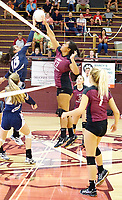 Photo by Randy Moll<br /> With Madison Ward and Madison Stanfill at the ready, Gentry's Chastery Fuamatu battles at the net against a Shiloh Christian player during Gentry's Sept. 7. The Gentry girls put up a strong fight but lost the match in three sets.