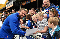 Tom Dunn of Bath Rugby mingles and signs autographs with supporters at the end of the session. Bath Rugby Captain's Run on October 30, 2015 at the Recreation Ground in Bath, England. Photo by: Patrick Khachfe / Onside Images