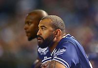 May 8, 2015; Phoenix, AZ, USA; San Diego Padres outfielder Matt Kemp (right) and Justin Upton in the dugout against the Arizona Diamondbacks at Chase Field. Mandatory Credit: Mark J. Rebilas-USA TODAY Sports