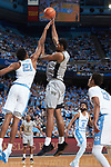 Doral Moore (4) of the Wake Forest Demon Deacons shoots over Sterling Manley (21) of the North Carolina Tar Heels during first half action at the Dean Smith Center on December 30, 2017 in Chapel Hill, North Carolina.  The Tar Heels defeated the Demon Deacons 73-69.  (Brian Westerholt/Sports On Film)