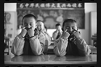 Jeminay County, Xinjiang Uygur Autonomous Region, China - Primary school students massage their eyes after class, October 2019.