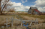 Idaho, North Central, Donnelly. Barn and equipment remains in the historic town of Roseberry.