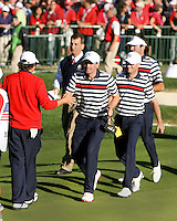 30 SEP 12  Keegan Bradley and teammates congratulate Jasin Dufner on his win on the 18th green during Sundays Singles matches  at The 39th Ryder Cup at The Medinah Country Club in Medinah, Illinois.                                          (photo:  kenneth e.dennis / kendennisphoto.com)