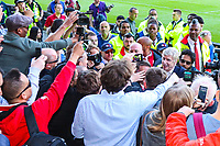 Arsenal manager surrounded by fans and photographers as he goes out to see the Arsenal fans after the Premier League match between Huddersfield Town and Arsenal at the John Smith's Stadium, Huddersfield, England on 13 May 2018. Photo by Thomas Gadd / PRiME Media Images.