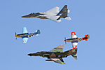 A pair of P-51D Mustangs represent World War II era aviation in formation with a QF-4 Phantom from the Vietnam Era and a F-15 Eagle from the modern day in an United States Air Force Heritage Flight during the 2006 National Championship Air Races at Stead Field in Nevada. The Air Force Heritage Flight program began in 1997 to commemorate the Air Force's 50th anniversary and has continued to combine aircraft from World War II, Korea, Vietnam, and state of the art fighters in formation flight displays. Photographed 09/06.