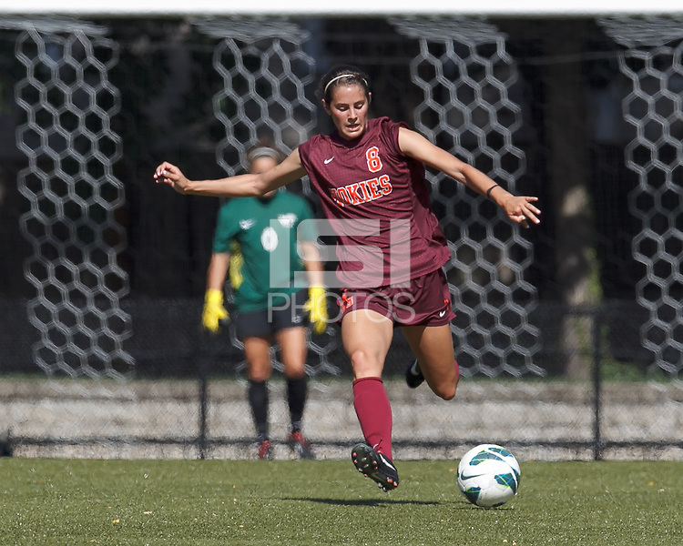 Virginia Tech defender Danielle King (8) clears the ball. Virginia Tech (maroon) defeated Boston College (white), 1-0, at Newton Soccer Field, on September 22, 2013.