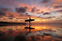 December 23, 2018 - San Diego, California, USA - A surfer walks out of the water during a low tide at sunset at La Jolla Shores Beach.   (Photo Credit: © K.C. ALFRED/ZUMA PRESS)