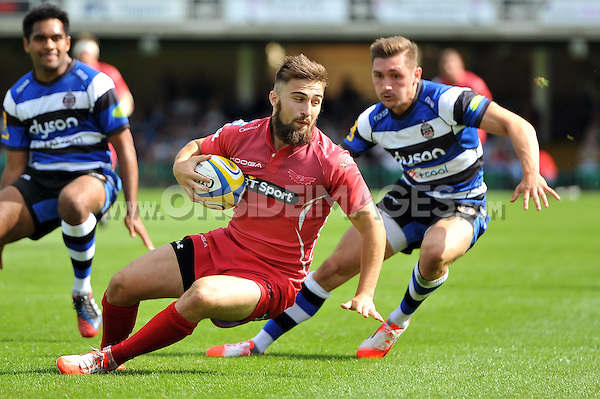 Jordan Williams gathers the ball. Pre-season friendly match, between Bath Rugby and the Scarlets on August 16, 2014 at the Recreation Ground in Bath, England. Photo by: Patrick Khachfe / Onside Images