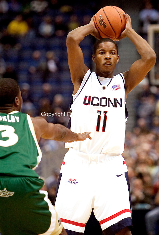 HARTFORD, CT. 02 January 2007-010207SV10--#11Jerome Dyson of UConn looks to pass as #3 Melvin Buckley of South Florida defends during basketball action at the Civic Center in Hartford Tuesday. <br /> Steven Valenti / Republican-American