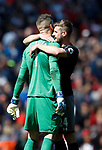 Jack Stephens of Southampton hugs Fraser Forster of Southampton after he saved a penalty during the English Premier League match at Anfield Stadium, Liverpool. Picture date: May 7th 2017. Pic credit should read: Simon Bellis/Sportimage