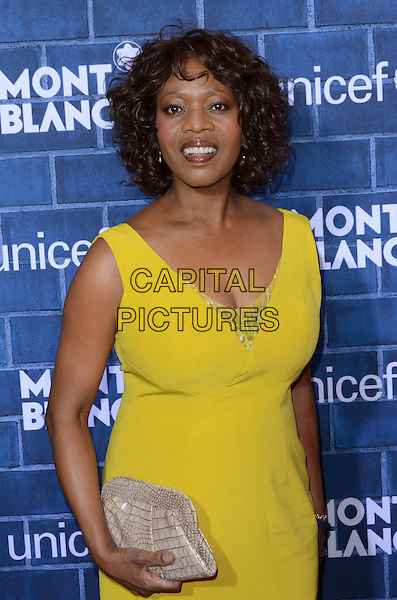 Alfre Woodard.Montblanc Hosts Pre-Oscar Charity Brunch Benefiting UNICEF held at Hotel Bel-Air, Los Angeles, California, USA..February 23rd, 2013.full length yellow dress silver clutch bag.CAP/ADM/TW.©Tonya Wise/AdMedia/Capital Pictures