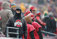 John Meyers, of Chicago, watches the snow fall before the college football game between the Ohio State Buckeyes and the Minnesota Golden Gophers at TCF Bank Stadium in Minneapolis, Saturday morning, November 15, 2014. The Ohio State Buckeyes defeated the Minnesota Golden Gophers 31 - 24. (The Columbus Dispatch / Eamon Queeney)