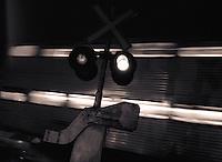 Train rushing behind at night.