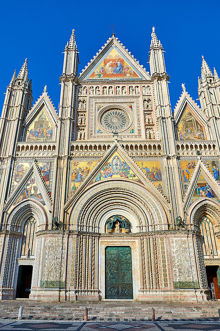 Facade close up of the14th century Tuscan Gothic style facade of the Cathedral of Orvieto, designed by Maitani, Umbria, Italy