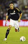 SANTANDER - SEPTEMBER 21:  Mesut Ozil of Real Madrid runs with the ball during the La Liga soccer match between Real Racing Club and Real Madrid at El Sardinero Stadium on September 21, 2011 in Santander, Spain. Photo by Victor Fraile / The Power of Sport Images