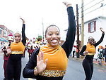 The Gazette. Frederick Douglass High School Marching Band dancers, from left, Victoria Mitchell, 17, April McGee, 16, and Natasha Peoples, 16, all of Upper Marlboro get the Marlboro Day festivities started as they dance down Main Street in Upper Marlboro on a rainy Saturday morning.