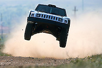 Ron Bailey of the US and his compatriot co-driver Kevin Heath drive their Hummer during the sixth stage of the Central Europe Rally, the first ever race of the Dakar Series near Veszprem, Hungary, Friday, April 25, 2008.