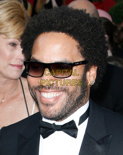 LENNY KRAVITZ.The 82nd Annual Academy Awards held aat The Kodak Theatre in Hollywood, California, USA..March 7th, 2010.oscars headshot portrait black tuxedo beard facial hair smiling bow tie piercing sunglasses shades .CAP/EAST.©Eastman/Capital Pictures.