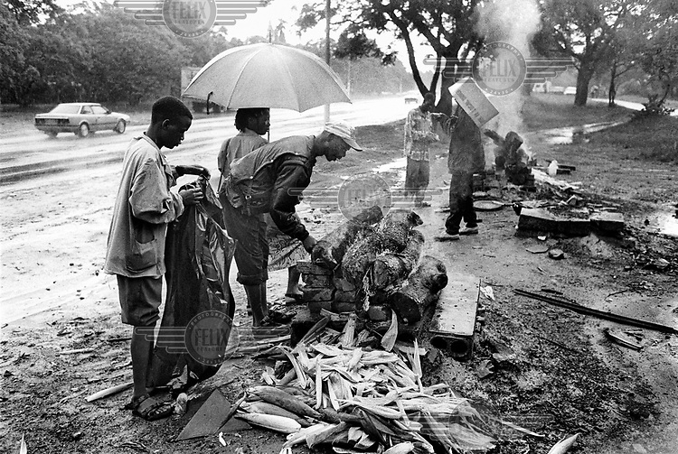 Street sellers in the rain along Enterprise Road in Harare.