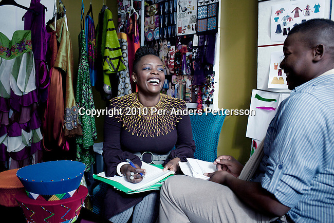 JOHANNESBURG, SOUTH AFRICA - MAY 17:  Nkhensani Nkosi, age 37, a mother of four and a celebrated fashion designer, entrepreneur, television personality and an actress, works with a designer in her studios on May 17, 2010, in Johannesburg, South Africa. Celebrated for her fashion brand Stoned Cherry her clothes are worn by celebrities and she had a successful show at the New York Fashion Week in 2009. (Photo by Per-Anders Pettersson)