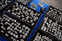Rings decorated with skulls are on sale at a vendor's tent at the Testicle Festival at the Rock Creek Lodge in Clinton, MT.  The Rock Creek Lodge in Clinton, MT, has hosted the annual Testicle Festival since the early 1980s.  The four day festival and party revolves around the consumption of so-called Rocky Mountain Oysters, which are deep-fried bull testicles.