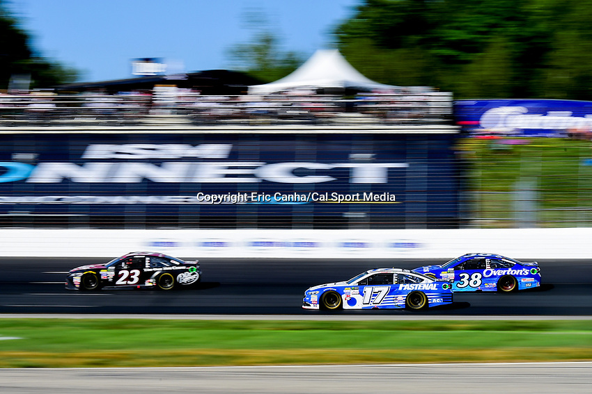 July 16, 2017 - Loudon, New Hampshire, U.S. - Ricky Stenhouse Jr, Monster Energy NASCAR Cup Series driver of the Fastenal Ford (17), takes the inside lane against Corey LaJoie,driver of the Dr Pepper Toyota (23), and David Ragan,driver of the Overton's Ford (38), at  the NASCAR Monster Energy Overton's 301 race held at the New Hampshire Motor Speedway in Loudon, New Hampshire. Eric Canha/CSM