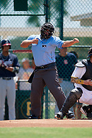 Umpire Denver Dangerfield calls a strikeout during a Gulf Coast League game between the GCL Braves and GCL Pirates on July 30, 2019 at Pirate City in Bradenton, Florida.  GCL Braves defeated the GCL Pirates 10-4.  (Mike Janes/Four Seam Images)