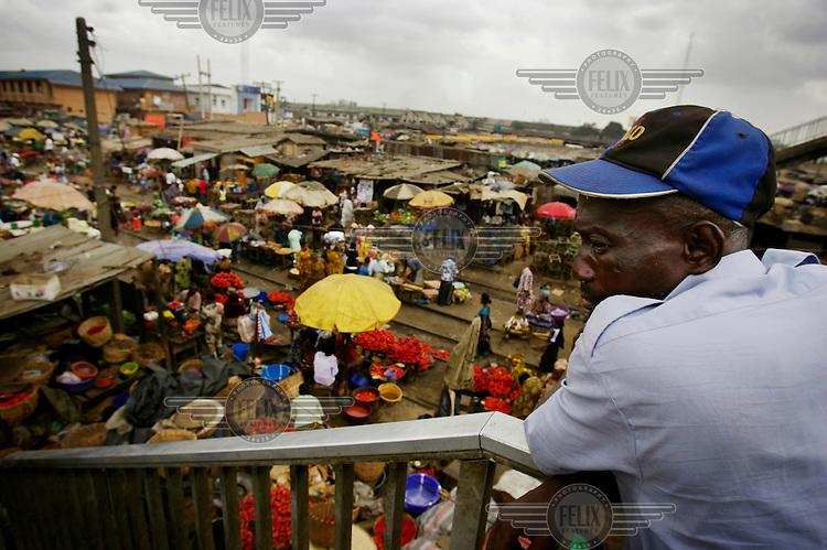 A man looks down on Oshodi market.