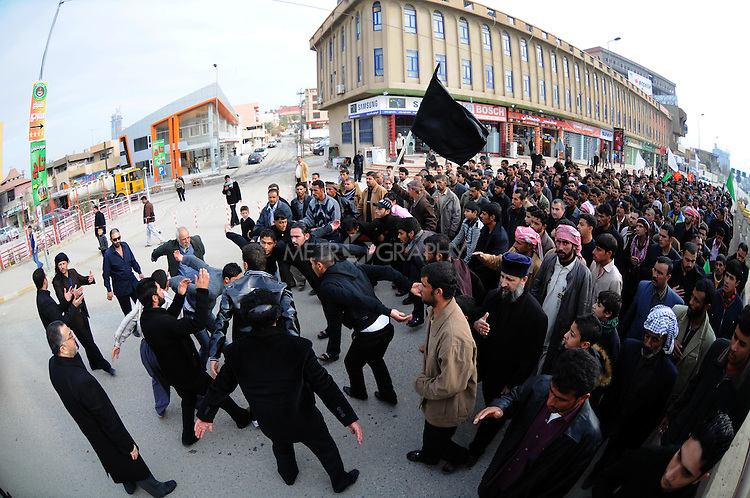 IRAQ, SULAIMANIYAH:  Shia men beat themselves in the street as part of the Shia holiday of Ashura...Around 500 hundred worshipers, many of them internally displaced Arabs, celebrated the Shia holiday of Ashura--the mourning of the death of the grandson of the Islamic prophet Mohammed.  ..Photo by Kamaran Najm/Metrography