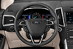 Car pictures of steering wheel view of a 2019 Ford Edge Titanium 5 Door SUV