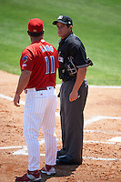 Clearwater Threshers manager Greg Legg (11) argues a call with umpire Mike Savakinas during a game against the Charlotte Stone Crabs on April 13, 2016 at Bright House Field in Clearwater, Florida.  Charlotte defeated Clearwater 1-0.  (Mike Janes/Four Seam Images)