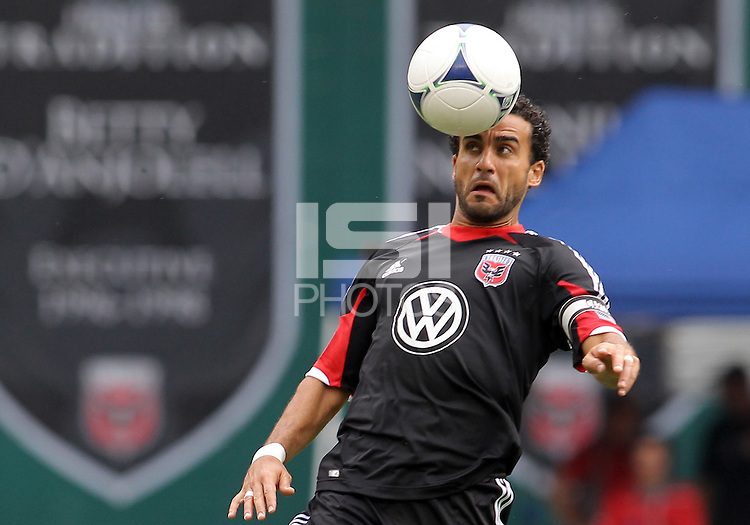 WASHINGTON, D.C. - AUGUST 19, 2012:  Dwayne DeRosario (7) of DC United heads the ball against the Philadelphia Union during an MLS match at RFK Stadium, in Washington DC, on August 19. The game ended in a 1-1 tie.