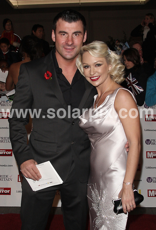 **ALL ROUND PICTURES FROM SOLARPIX.COM**                                             **WORLDWIDE SYNDICATION RIGHTS**                                                                                  Caption:  Arrivals for the Pride Of Britain Awards at the Grosvenor House Hotel, London, UK. 8 November 2010                                                                       This pic: Joe Calzaghi and Kristina Rihanoff    Job Ref: 12445 LNJ       DATE: 08_11_2010                                                           **MUST CREDIT SOLARPIX.COM OR DOUBLE FEE WILL BE CHARGED**                                                                      **MUST AGREE FEE BEFORE ONLINE USAGE**                               **CALL US ON: +34 952 811 768 or LOW RATE FROM UK 0844 617 7637**