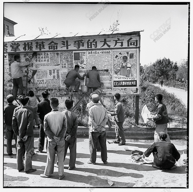 "Red Guards hang big character posters at Harbin?s University of Industry. The billboard reads, ""Follow Chairman Mao's great strategy and grasp the direction of revolutionary struggle."" Harbin, 4 September 1967"