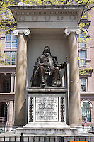A statue of Peter Cooper, the founder of Cooper Union, sits in front of the college's Foundation Building in the East Village neighborhood of New York on Sunday, April 28, 2013. The Cooper Union for the Advancement of Science and Art announced that it will start charging tuition for undergraduates for the first time since it opened in 1859. The monument is by noted sculptor Augustus Saint-Gaudens and the base is by noted architect Stanford White, installed in 1897. (© Richard B. Levine)