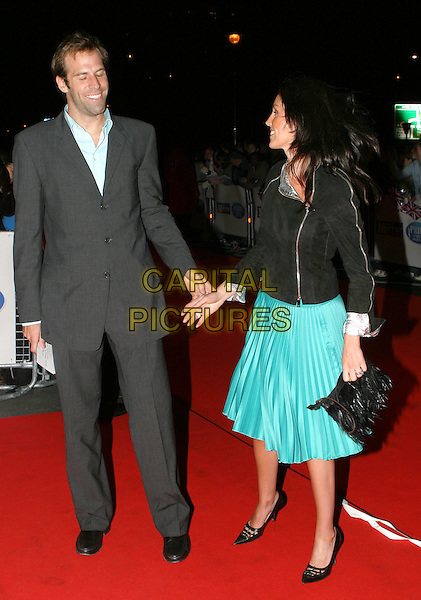 GREG RUSEDSKI & WIFE.Daily Mirror's Pride Of Britain Awards at the London Hilton, Park Lane.15 March 2004.full length, full-length, turquoise skirt, grey, gray suit.www.capitalpictures.com.sales@capitalpictures.com.© Capital Pictures.