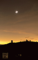 Total solar eclipse seen from Mauna Kea. The luminous surface of the Sun (the photosphere) is completely hidden by the moon, revealing the solar corona - the tenuous very hot outer atmopshere of the Sun.  The unusual color of the sky is caused by th