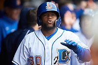 Dashenko Ricardo (30) of the Durham Bulls celebrates with his teammates after hitting a home run against the Gwinnett Braves at Durham Bulls Athletic Park on April 20, 2019 in Durham, North Carolina. The Bulls defeated the Braves 11-3 in game one of a double-header. (Brian Westerholt/Four Seam Images)