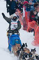 Kim Darst team leaves the start line during the restart day of Iditarod 2009 in Willow, Alaska