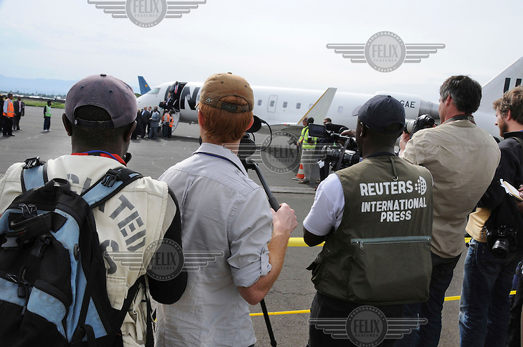 Foreign journalists document the arrival of UN Secretary General Ban Ki-Moon in Goma.