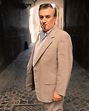 ITALY, Orvieto, Umbria, portrait of Giancarlo Parreti with cigar.
